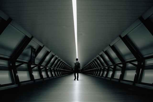 man standing inside building