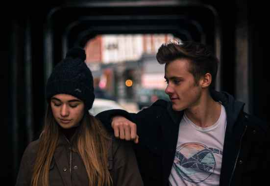 young couple in city at night