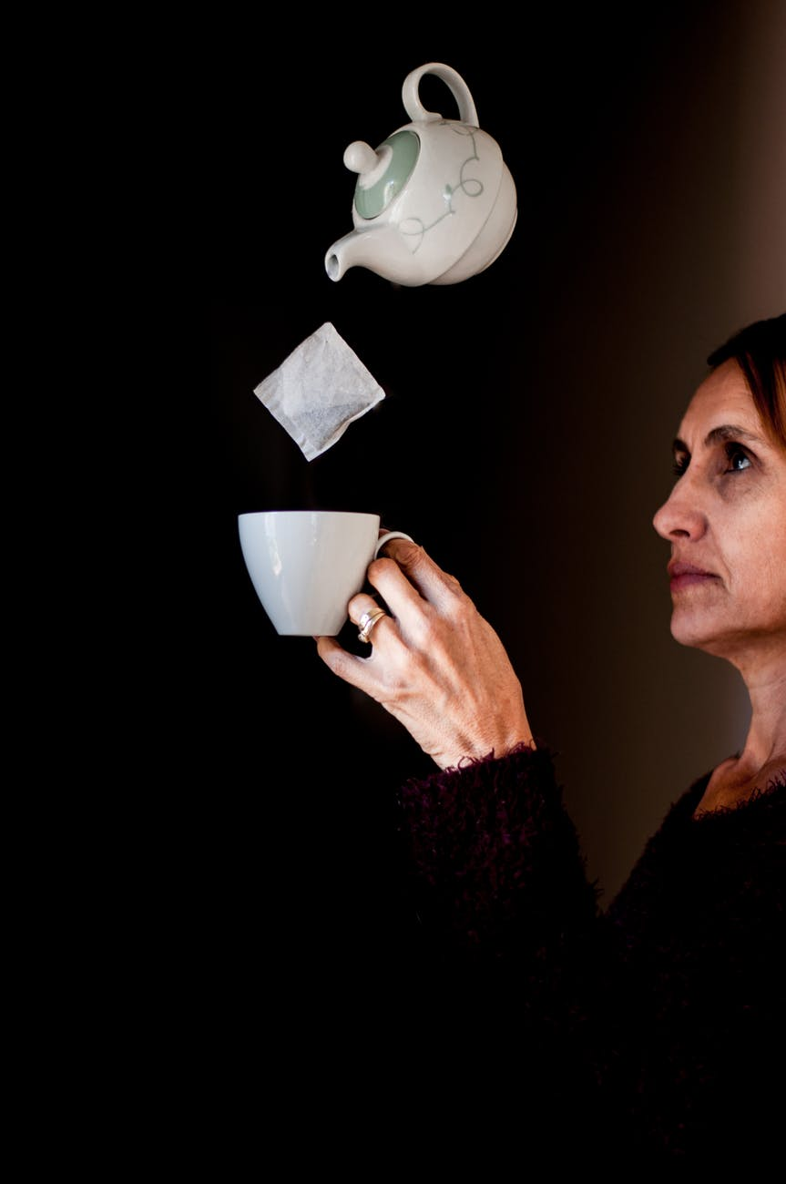 woman holding teacup