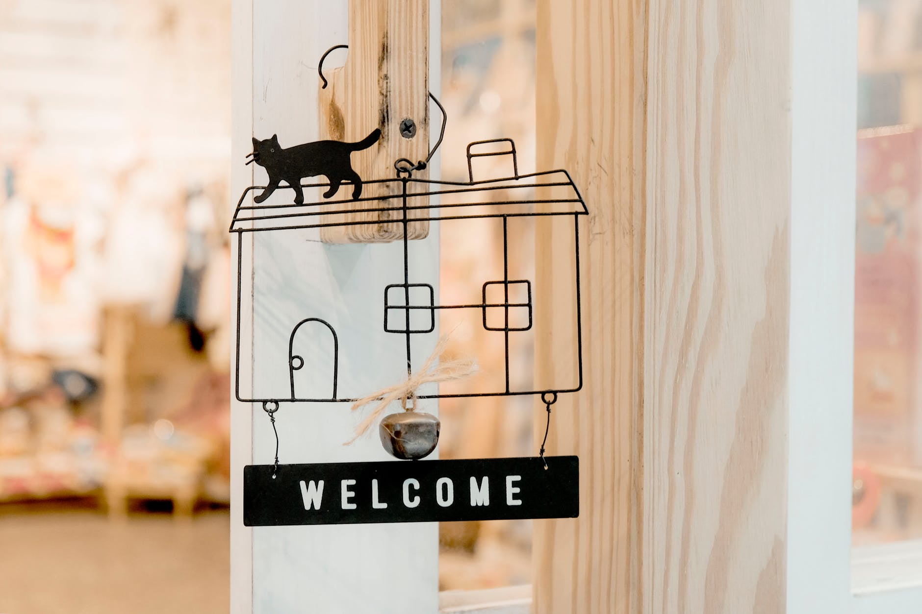 black steel welcome hanging signage
