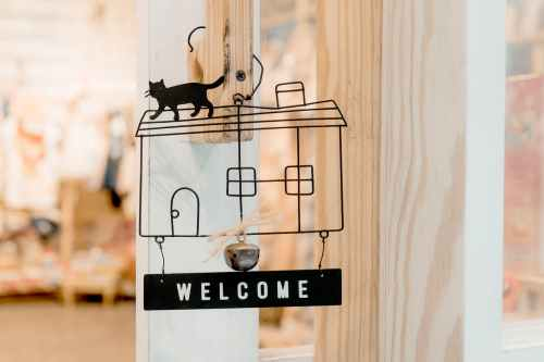 black steel welcome hanging signage