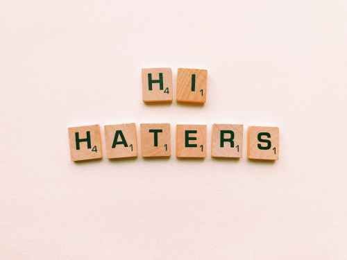 hi haters scrabble tiles on white surface