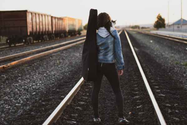 woman standing on train rail