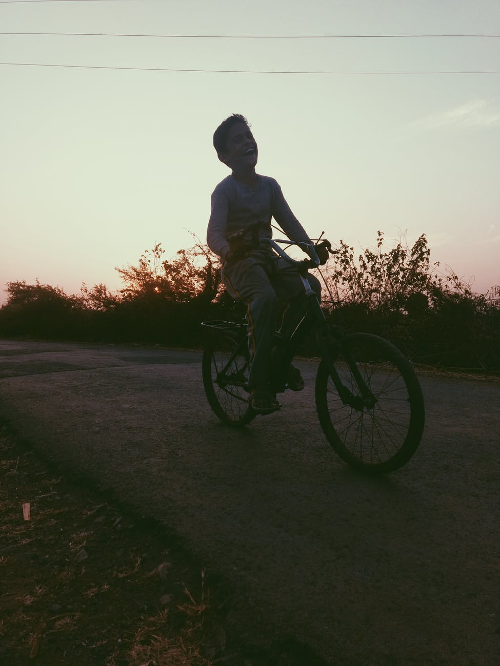 boy riding of bicycle