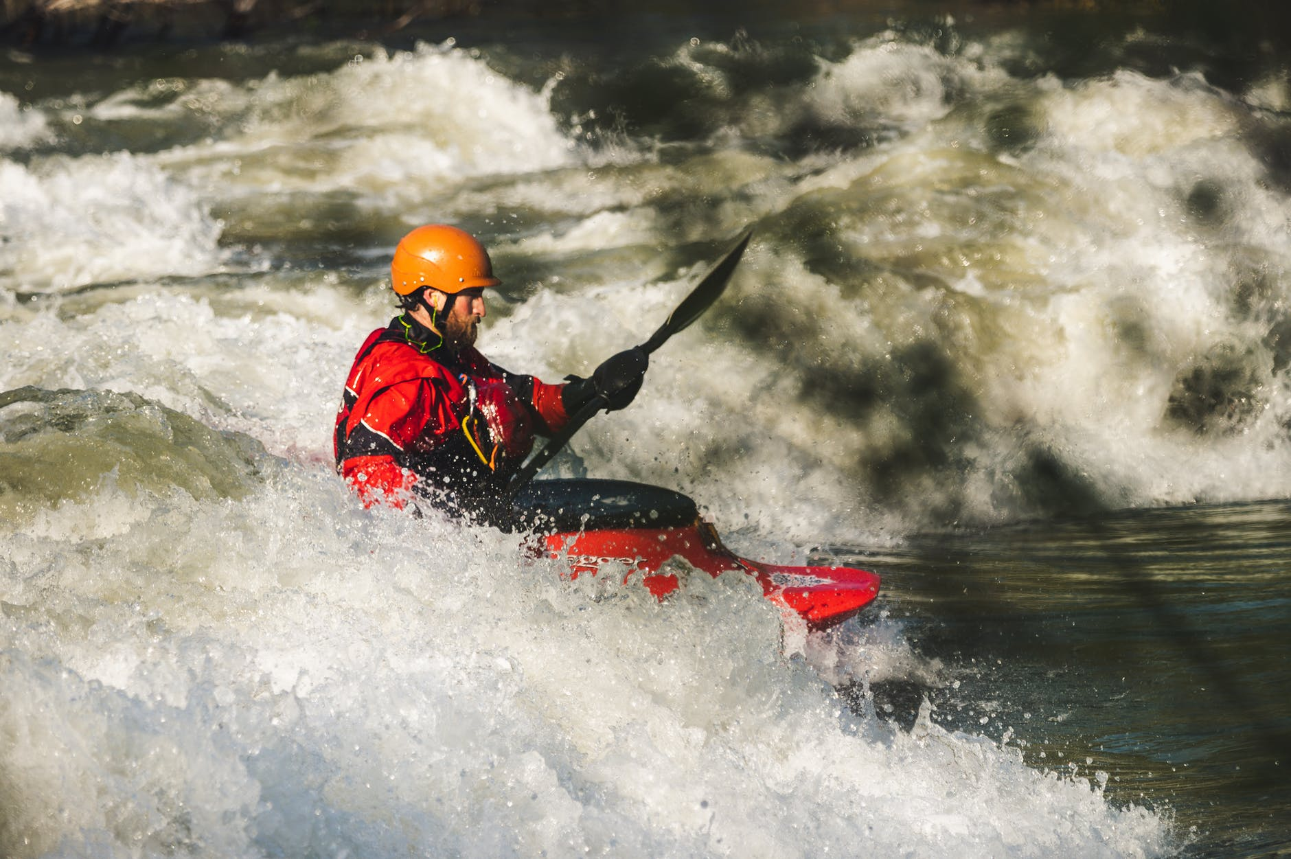 man on red watercraft