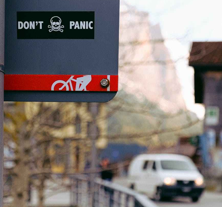 don t panic sticker on sign